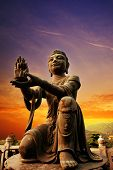 Buddhistic statue praising and making offerings to the Tian Tan Buddha (Hong kong Lantau)