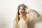 Funny Hipster Girl in Winter Clothes Going Crazy poster