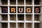 Drugs Concept Wooden Letterpress Type In Draw poster