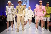 MOSCOW - FEBRUARY 22: Models wear light suits from Slava Zaytzev and walk the catwalk in Collection