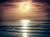 Colorful Sky With Dark Cloud And Bright Full Moon Over Seascape. poster