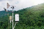 Meteorological Weather Station Antenna With Meteorology Sensors, Pale Overcast Cloudy Sky And Forest poster