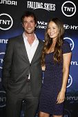 LOS ANGELES - JUN 13: Noah Wyle, Moon Bloodgood at the premiere of TNT's 'Falling Skies' held at the