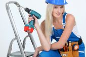 stock photo of bimbo  - bimbo with drill - JPG