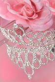 picture of pageant  - Mirror reflection of a beautiful diamond or rhinestone crown for a beauty pageant or wedding with pink roses in the background