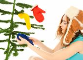 Woman Dressing Christmas Tree