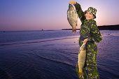 Happy Fisherwoman Holding Big Carps
