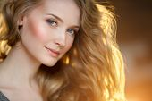 Romantic blonde. Young beautiful cute woman. Beauty girl with long shiny hair, glowing skin and volu poster