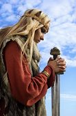 image of armor suit  - Portrait of the blonde girl in the Scandinavian suit with sword - JPG