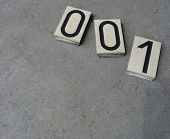 Plastic 0 1 Zero One Number On Gray Stone Surface