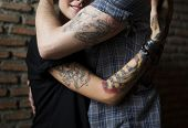 Tattoo Couple Embracing With Passion poster