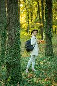 Autumn Woman. Pretty Woman Walking In The Park And Enjoying The Beautiful Autumn Nature. Warm Sunny  poster