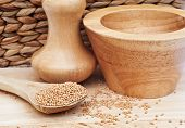 Mustard Seeds In Rustic Kitchen Setting With Pestle And Mortar