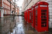 stock photo of phone-booth  - Row of phone booths in rainy London - JPG