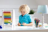 Child Doing Homework At Home. Little Boy With Wooden Colorful Abacus Doing Math Exercise Learning Ad poster