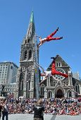 Acrobats Perform On A Ladder In Front Of The Cathedral At The World Buskers Festival.