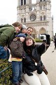 Tourists Near Notre Dame De Paris poster