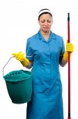 Pretty cleaning lady with bucket and broom crying isolated on white