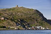 Cabot tower on the top of Signal Hill and the residential area of the Lower Battery on the lower slo