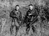 Man Hunters With Rifle Gun. Boot Camp. Hunting Skills And Weapon Equipment. How Turn Hunting Into Ho poster