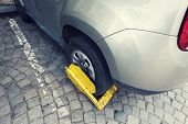 Car With Yellow Clamp On A Wheel Parked In A City Parking Selective Focus poster