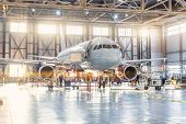 View Inside The Aviation Hangar, The Airplane Mechanic Working Around The Service poster
