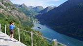Tourism Holidays Pictures And Traveling. Mature Female Tourist Enjoying Scenic Fjord Landscape Geira poster