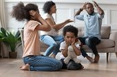 Upset African Kids Closing Ears Hurt By Parents Fighting poster
