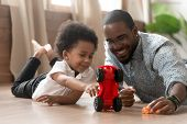 Cute Little African Kid Son Playing Toy Cars With Dad poster