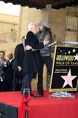 LOS ANGELES, CA - MAR 16: Malcolm McDowell, Rob Zombie at a ceremony where Malcolm McDowell is honored with a star on the Hollywood Walk of Fame on March 16, 2012 in Los Angeles, California