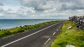 Irish Landscape With The Sea And The Rural Coastal R477 Road Along ​​the Burren, Geosite And Geopark poster