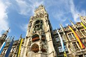 Munchen: Marienplatz, New Town Hall and Frauenkirche poopular tourist destination and city center poster