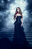 Fantasy Woman In Black Dress Smelling Rose Flower, Mystic Girl In Long Retro Gothic Gown poster