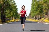 image of workout-women  - Sport fitness running woman jogging during outdoor workout - JPG