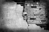 Old stucco wall with cracked cracks plaster and bricks poster