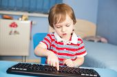 Little Baby Boy Typing On Computer Keyboard