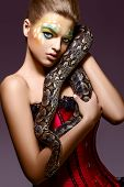 Beautiful Woman Holding Python Snake In Hands - Performance