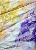A closeup of silk fabric dyed in batik technique