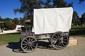 stock photo of old spanish trail  - A 1800s wagon coverd with white canvas - JPG