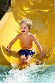 Boy on a water slide