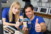 Two Dental Technicians With Articulator Showing Thumbs Up
