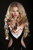 Sexy Blond Woman Shooting Gun Isolated On Black Background