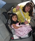 Native American Girl In A Child Safety Seat
