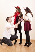 Boyfriend give gift to his girlfriend while another girlfriend is interfering between