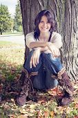 Out Doorsy Young Woman Leaning Against Tree In Fall