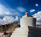 Whitewashed chorten and Tsemo fort and gompa. Leh, Ladakh, India