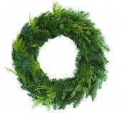 stock photo of conifers  - green christmas wreath isolated on white background - JPG