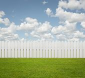 stock photo of wooden fence  - Close up of white fence on the grass with copy space - JPG