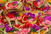 stock photo of hindu-god  - Traditional balinese offerings to gods in Bali with flowers and aromatic sticks - JPG