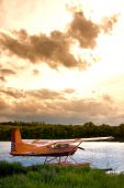 image of float-plane  - A prairie storm approaching a lake where a float plane rests. ** Note: Slight graininess, best at smaller sizes - JPG